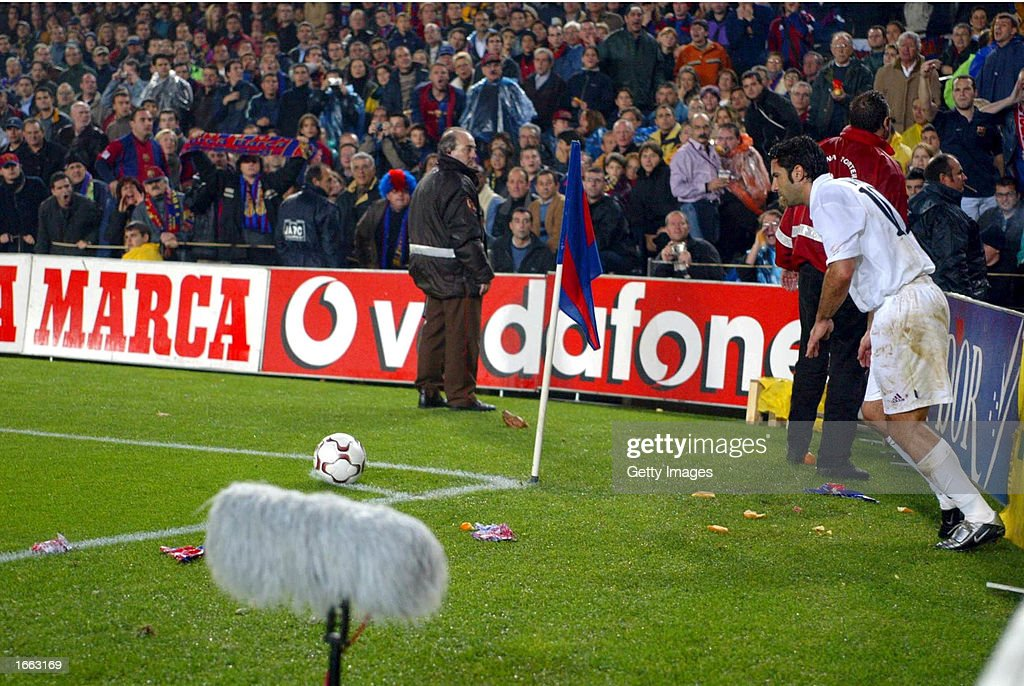 Luis Figo of Real Madrid is bombarded by missiles as he attempts to take a corner during the La Liga match between FC Barcelona and Real Madrid...