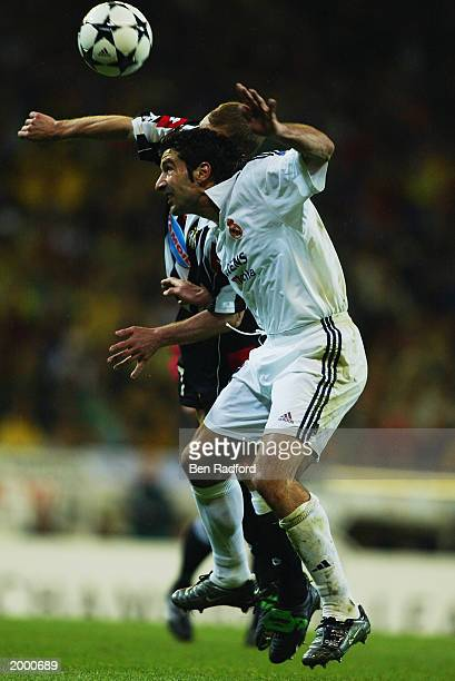 Luis Figo of Real Madrid is challenged by Gianluca Pessotto of Juventus during the Champion's League Semi Final between Real Madrid and Juventus on...
