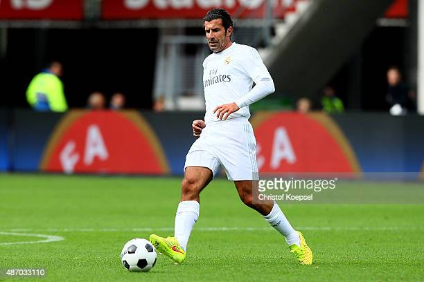 Luis Figo of Real Madrid Legends runs with the ballduring the Laureus KickOffForGood Charity Match between Laureus All Stars against Real Madrid...