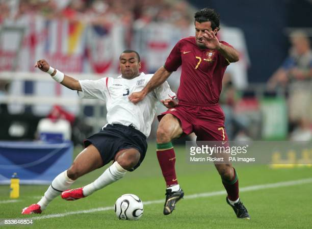 Luis Figo Portugal and Ashley Cole England battle for the ball