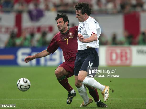 Luis Figo Portugal and Owen Hargreaves England battle for the ball