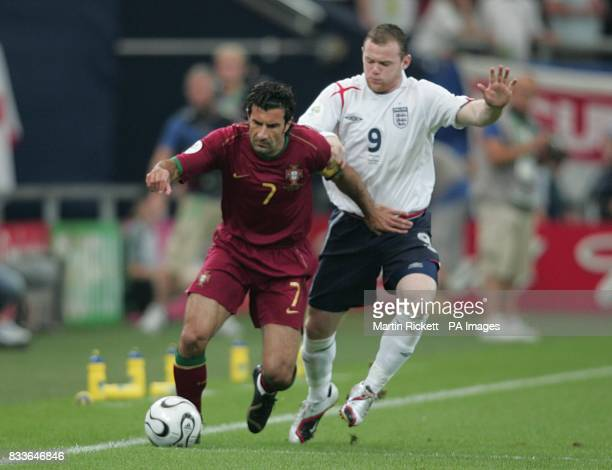 Luis Figo Portugal and Wayne Rooney England battle for the ball