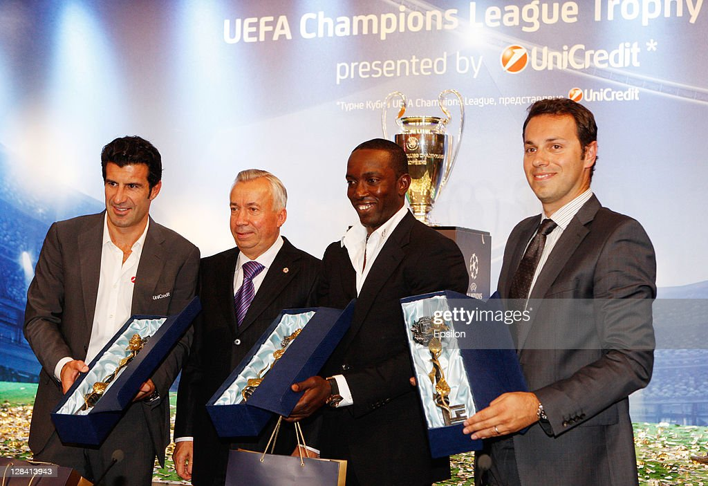<a gi-track='captionPersonalityLinkClicked' href=/galleries/search?phrase=Luis+Figo&family=editorial&specificpeople=201507 ng-click='$event.stopPropagation()'>Luis Figo</a>,the Official UniCredit Ambassador for the UEFA Champions League, Donetsk mayor Alexander Lukyanchenko with <a gi-track='captionPersonalityLinkClicked' href=/galleries/search?phrase=Dwight+Yorke&family=editorial&specificpeople=206855 ng-click='$event.stopPropagation()'>Dwight Yorke</a>, UEFA Champions League Trophy Tour Ambassador and Gregory Biskos, Press & Research Officer during the UEFA Champions League Trophy Tour 2011 on October 07, 2011 in Donetsk, Ukraine.