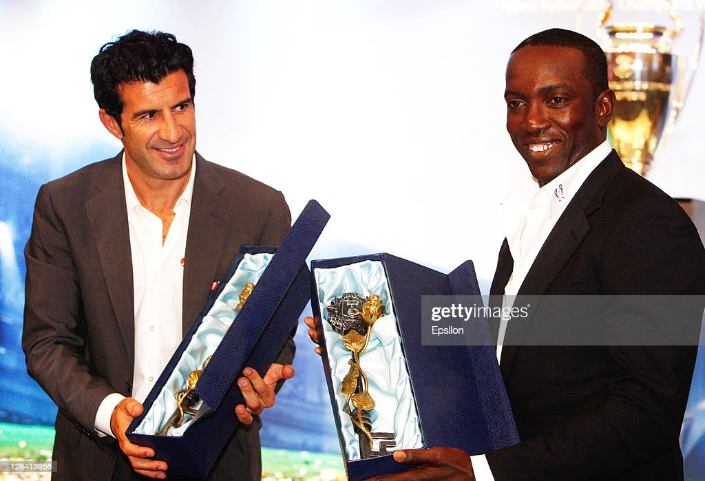 Luis Figo,the Official UniCredit Ambassador for the UEFA Champions League (L) with <a gi-track='captionPersonalityLinkClicked' href=/galleries/search?phrase=Dwight+Yorke&family=editorial&specificpeople=206855 ng-click='$event.stopPropagation()'>Dwight Yorke</a>, UEFA Champions League Trophy Tour Ambassador during the UEFA Champions League Trophy Tour 2011 on October 07, 2011 in Donetsk, Ukraine.