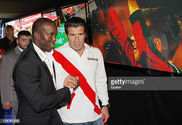 Luis Figothe Official UniCredit Ambassador for the UEFA Champions League and Dwight Yorke UEFA Champions League Trophy Tour Ambassador during the...