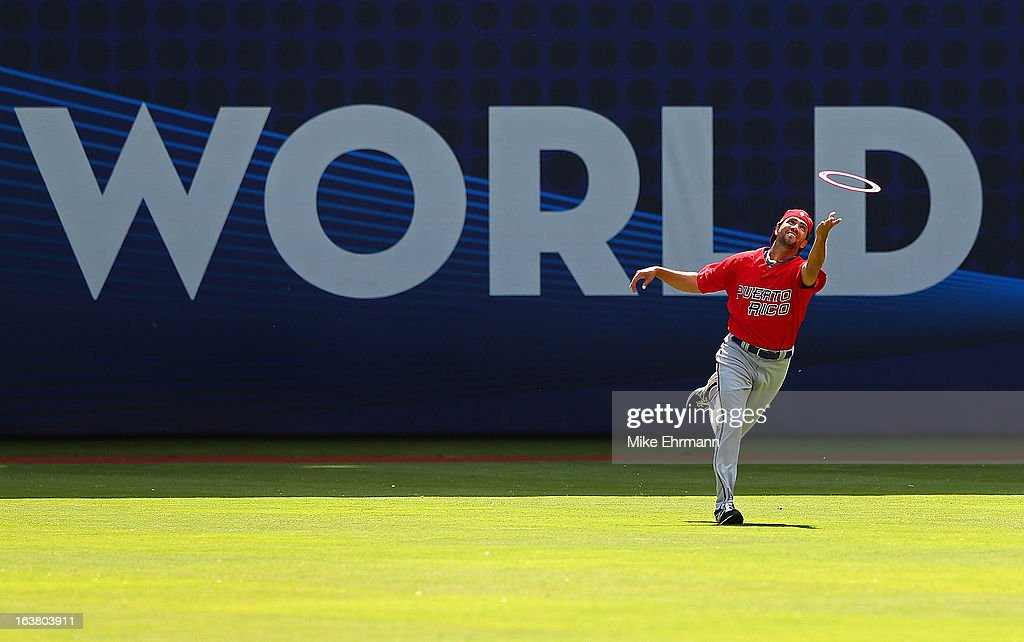 Luis Figueroa #3 of Puerto Rico chases down a frisbee during a World Baseball Classic second round game against the Dominican Republicat Marlins Park on March 16, 2013 in Miami, Florida.