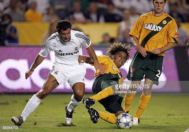 Luis Filipe Figo of the Real Madrid and Guillermo Pando Ramirez of the Los Angeles Galaxy clash during the game at the Home Depot Center on July 18...