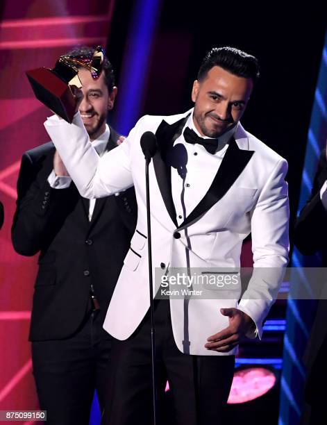 Luis Fonsi accepts the Record of the Year award onstage at the 18th Annual Latin Grammy Awards at MGM Grand Garden Arena on November 16 2017 in Las...