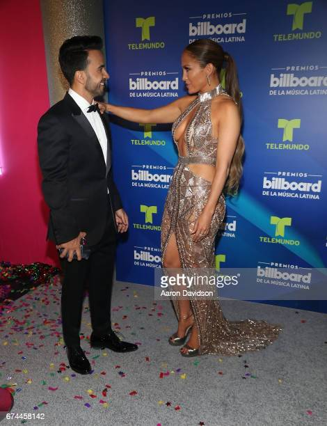 Luis Fonsi and Jennifer Lopez poses backstage during the Billboard Latin Music Awards at Watsco Center on April 27 2017 in Coral Gables Florida