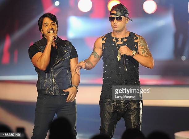 Luis Fonsi and Wisin perform onstage during the 2014 Billboard Latin Music Awards at Bank United Center on April 24 2014 in Miami Florida