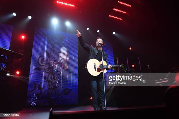 Luis Fonsi performs in concert during Love Dance World Tour at Coca Cola Roxy on September 24 2017 in Atlanta Georgia