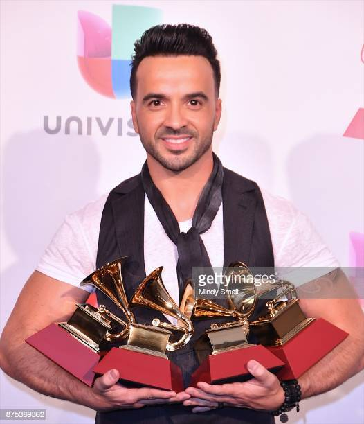Luis Fonsi poses with awards for Best Urban Fusion/Performance Best Short Form Music Video Song of the Year and Record of the Year in the press room...