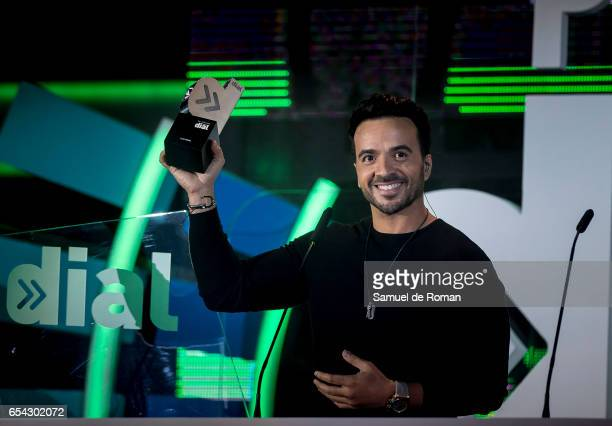 Luis Fonsi receives an award at the Cadena Dial Awards on March 16 2017 in Tenerife Spain