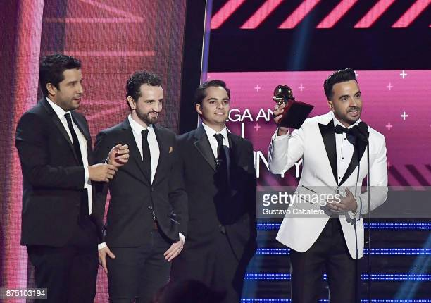 Luis Fonsi with producers Mauricio Rengifo Andres Torres and Luis Saldarriaga accept the Record of the Year award for 'Despacito' onstage during The...