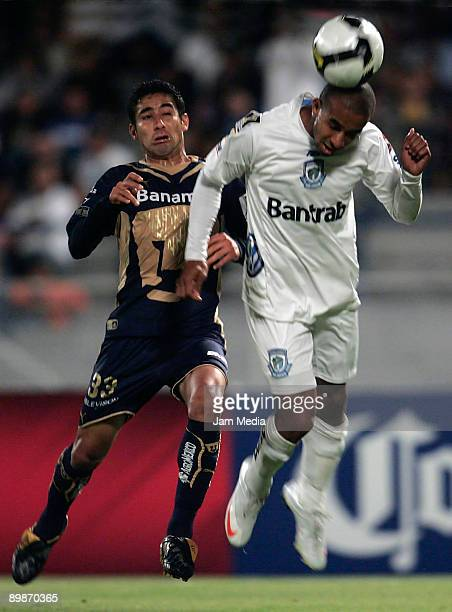 Luis Fuentes of Mexico's Pumas UNAM vies for the ball with Luis Bradley of Guatemala's CSD Comunicaciones during their match for the Concacaf...
