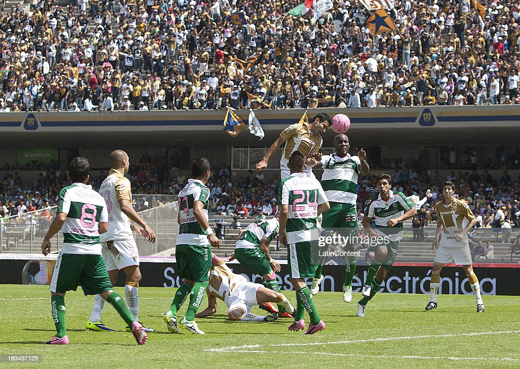 Luis Fuentes of Pumas fights for the ball with Felipe Balloy of Santos during a match between Pumas and Santos as part of the Apertura 2013 Liga MX at Olympic Stadium on October 06, 2013 in Mexico City, Mexico.