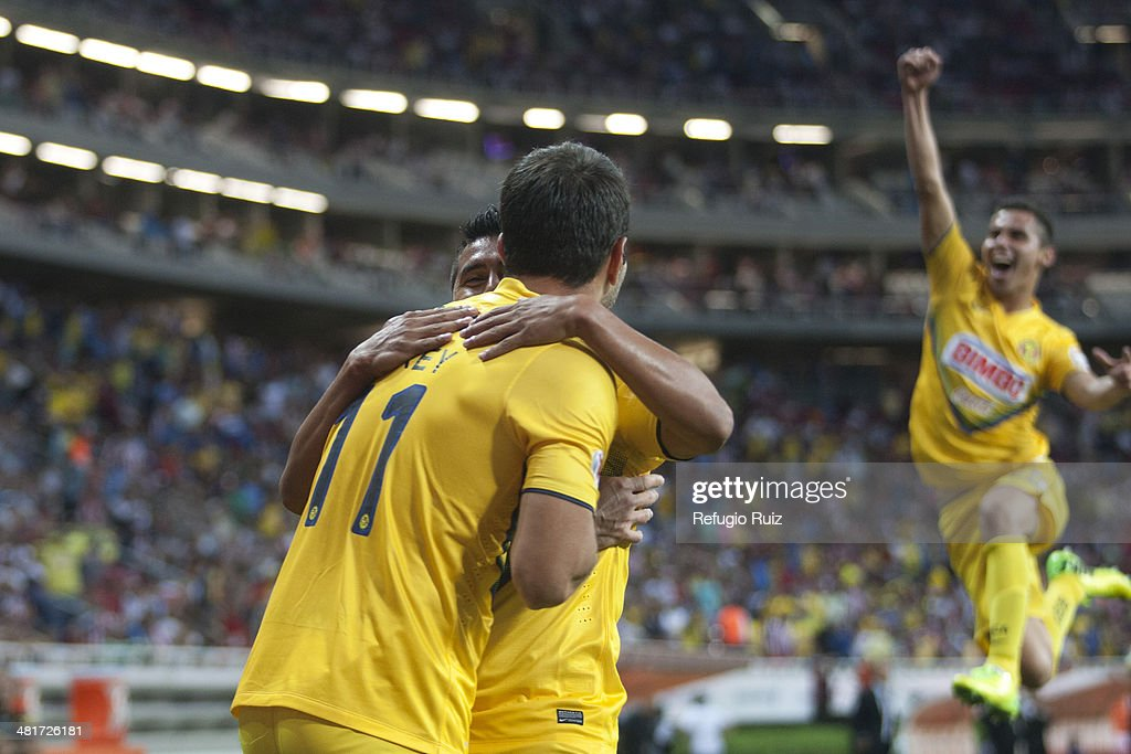 Luis Gabriel Rey Paul Aguilar and Raul Jimenez of America celebrate the second goal against Chivas during a match between Chivas and America as part...