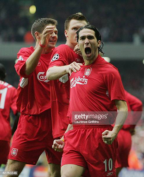 Luis Garcia of Liverpool celebrates scoring the opening goal with John Arne Riise and Steve Gerrard during the UEFA Champions League semifinal second...