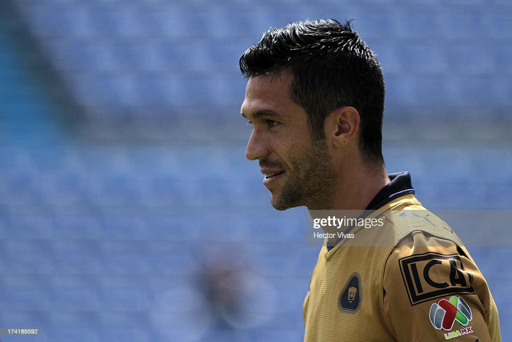 Luis Garcia of Pumas smiles during a match between Pumas and Puebla as part of the Torneo Apertura 2013 Liga Mx at Cuauhtemoc Stadium on July 21, 2013 in Puebla, Mexico.