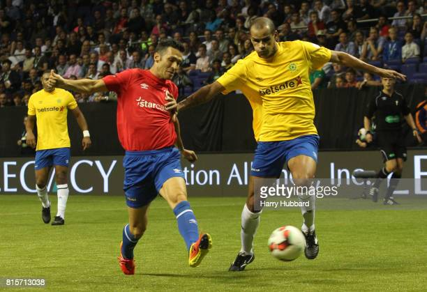 Luis Garcia of Spain and Rivaldo of Brazil in action during the 3rd Place Play off Star Sixes match between Spain and Brazil at The O2 Arena on July...