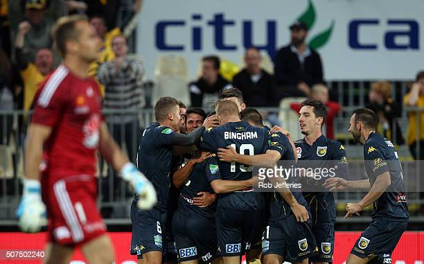 Luis Garcia of the Central Coast Mariners is surrounded by his teammates after scoring a goal during the round 17 ALeague match between the...