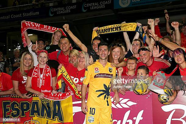 Luis Garcia of the Mariners poses for a photo with fans from other clubs during the round 16 ALeague match between the Central Coast Mariners and the...