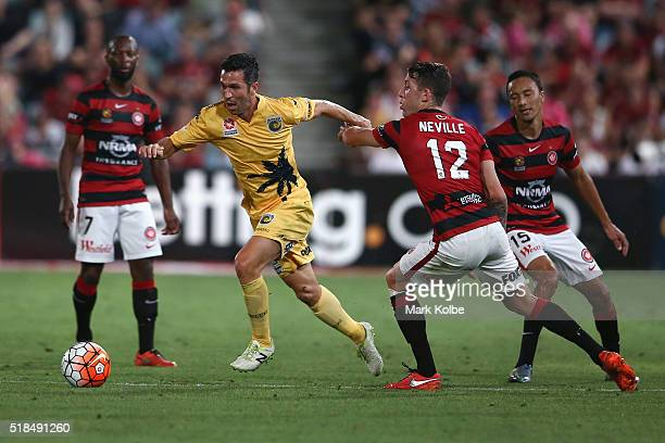Luis Garcia of the Mariners takes the ball past defender Scott Neville of the Wanderers during the round 26 ALeague match between the Western Sydney...