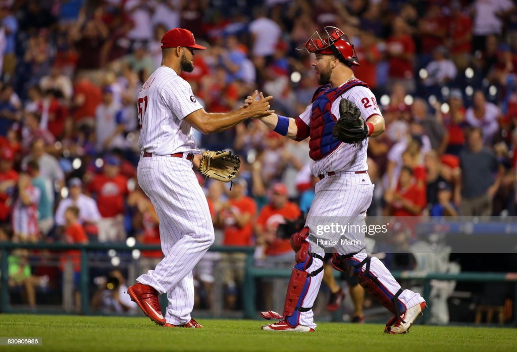 Luis Garcia #57 of the Philadelphia Phillies celebrates with Cameron Rupp #29 after saving a game against the New York Mets at Citizens Bank Park on August 12, 2017 in Philadelphia, Pennsylvania. The Phillies won 3-1.