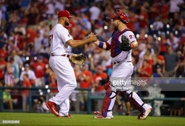 Luis Garcia of the Philadelphia Phillies celebrates with Cameron Rupp after saving a game against the New York Mets at Citizens Bank Park on August...