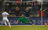 Luis Gil of the USA scores on a penalty kick past goalkeeper Max Crepeau of Canada in the 92nd minute of the 2015 CONCACAF Olympic Qualifying match...