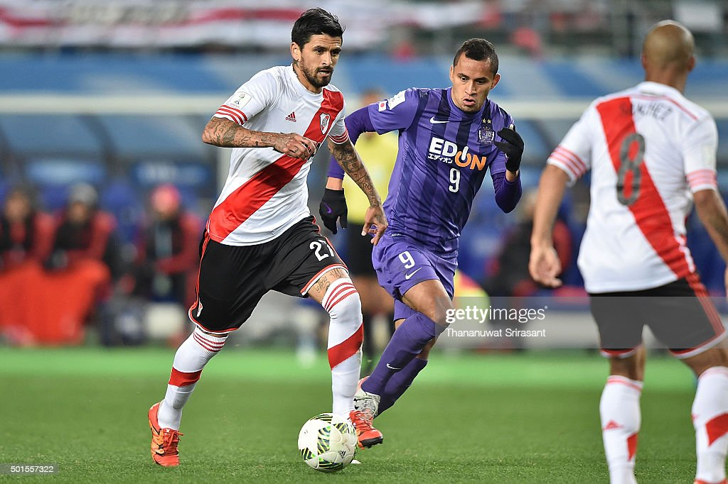 Luis Gonzalez of River Plate and Douglas of Sanfrecce Hiroshima runs during the FIFA Club World Cup semifinals between the Sanfrecce Hiroshima and...