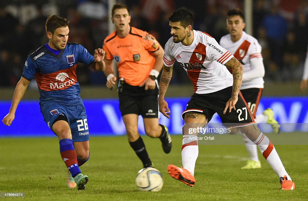 Luis Gonzalez of River Plate and Lucas Ariel Menossi of Tigre fight for the ball during a match between Tigre and River Plate as part of 13th round of Torneo Primera Division 2015 at Jose Dellagiovanna Stadium on July 08, 2015 in Victoria, Argentina.