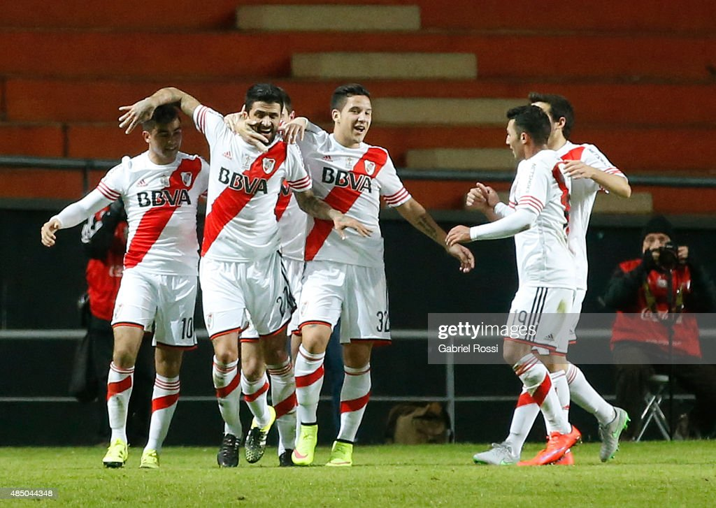 Luis Gonzalez of River Plate and teammates celebrate their team's first goal during a match between Estudiantes and River Plate as part of 21st round...