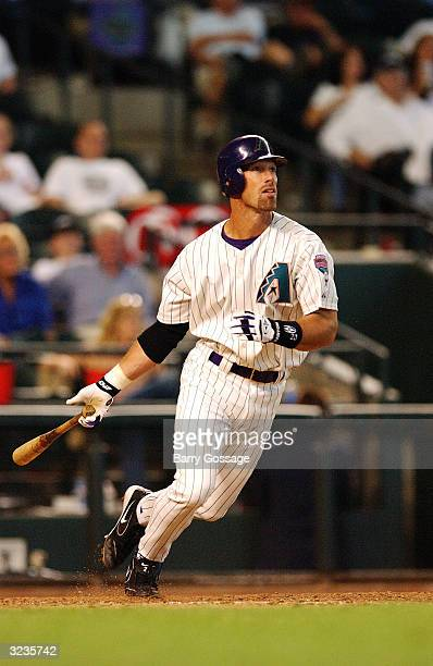 Luis Gonzalez of the Arizona Diamondbacks hits his second home run of the day during the Opening Day game against the Colorado Rockies at Bank One...
