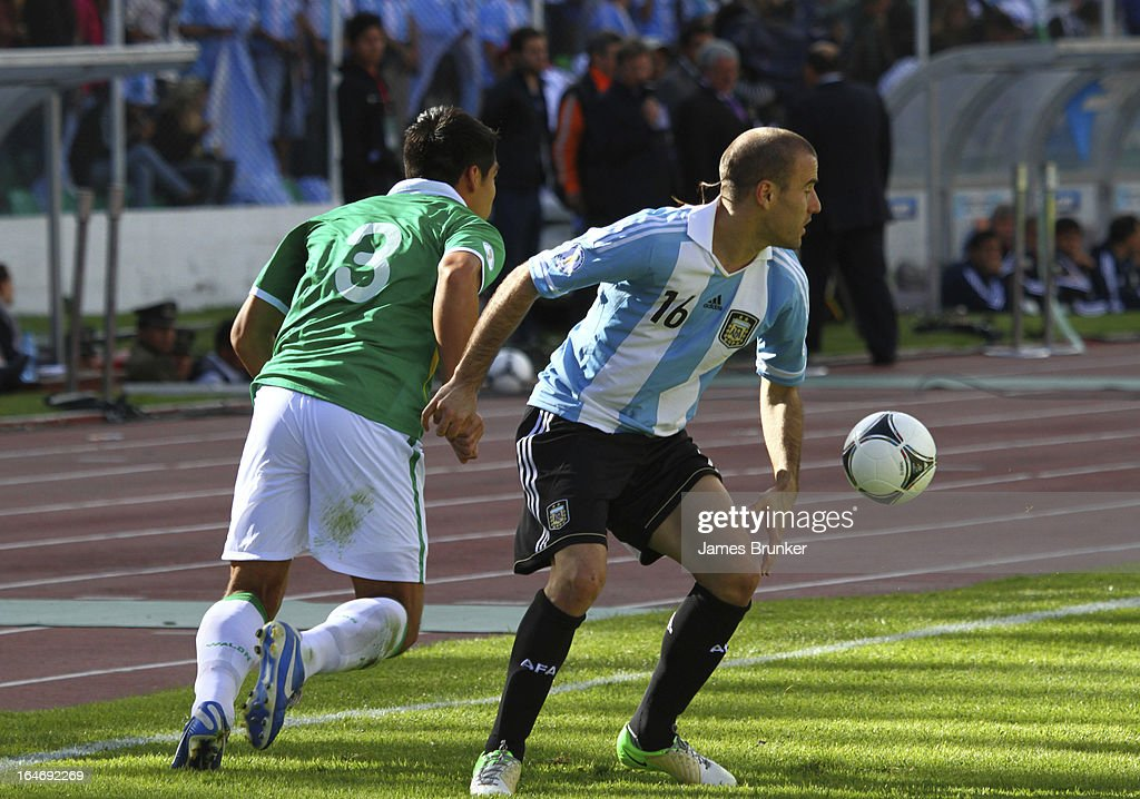 Luis Gutierrez (#3) fights for the ball with <a gi-track='captionPersonalityLinkClicked' href=/galleries/search?phrase=Rodrigo+Palacio&family=editorial&specificpeople=490993 ng-click='$event.stopPropagation()'>Rodrigo Palacio</a> (#16) of Argentina during a match between Bolivia and Argentina as part of the 12th round of the South American Qualifiers for the FIFA World Cup Brazil 2014 at the Hernando Siles Stadium on March 26, 2013 in La Paz, Bolivia.