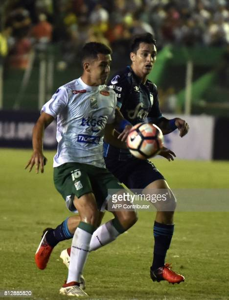 Luis Haquin of Oriente Petrolero of Bolivia vies for the ball with Fernando Sampedri of Atletico Tucuman of Argentina during their Sudamericana Cup...