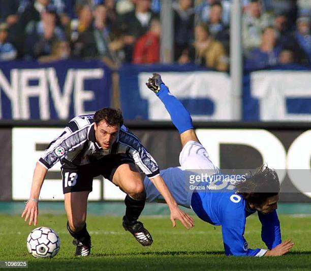 Luis Helguera of Udinese and Andrea Pirlo of Brescia in action during a SERIE A 18th Round League match between Brescia and Udinese played at the...