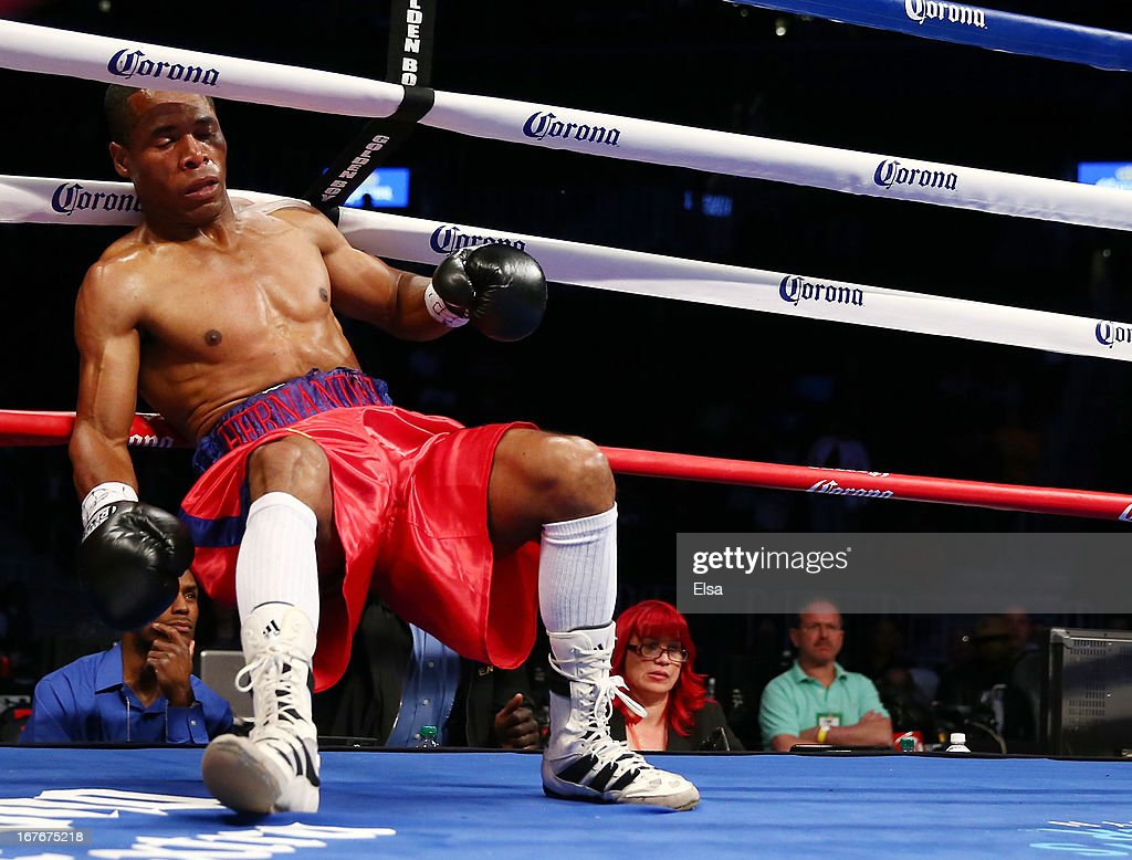 Luis Hernandez is knocked down by Eddie Gomez at Barclays Center on April 27, 2013 in the Brooklyn borough of New York City.