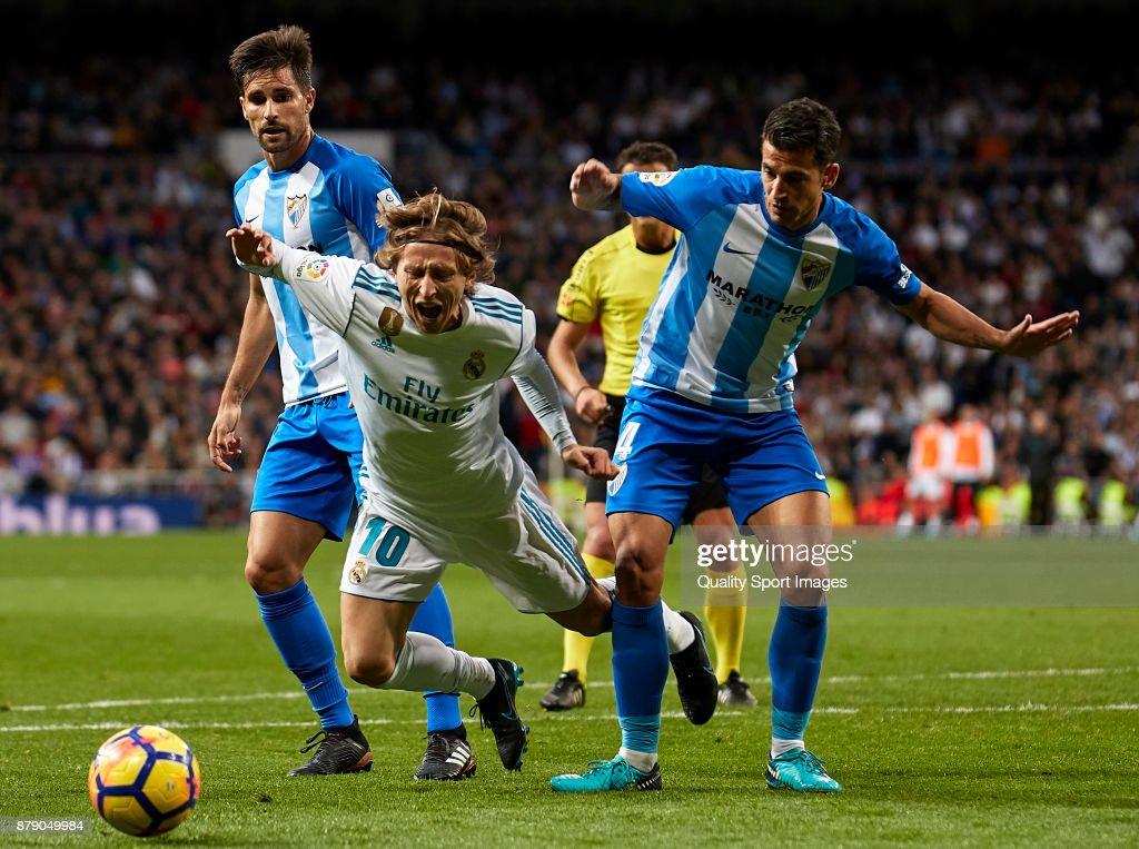 Luis Hernandez of Malaga CF makes penalty to Luka Modric of Real Madrid during the La Liga match between Real Madrid and Malaga at Estadio Santiago Bernabeu on November 25, 2017 in Madrid, Spain.