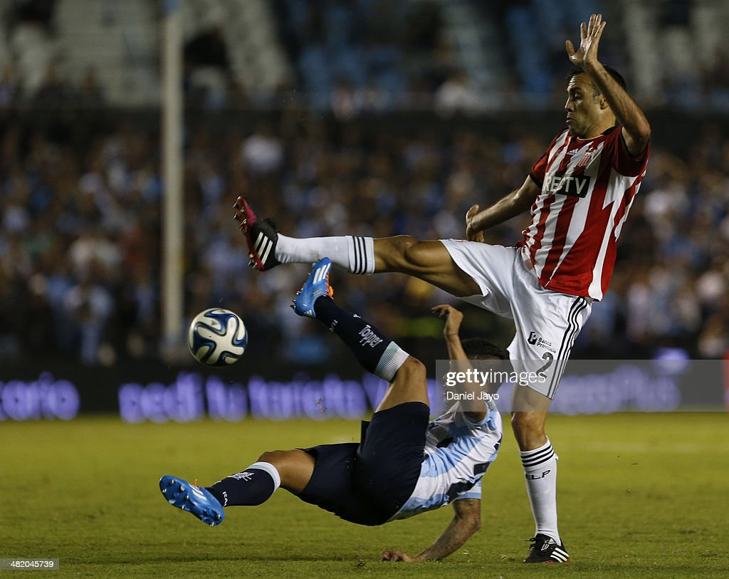 Luis Ibanez of Racing Club(L) and Leandro Desabato of Estudiantes fight for the ball during a match between Racing Club and Estudiantes as part of 11th round of Torneo Final 2014 at Presidente Peron Stadium on April 1, 2014 in Buenos Aires, Argentina.
