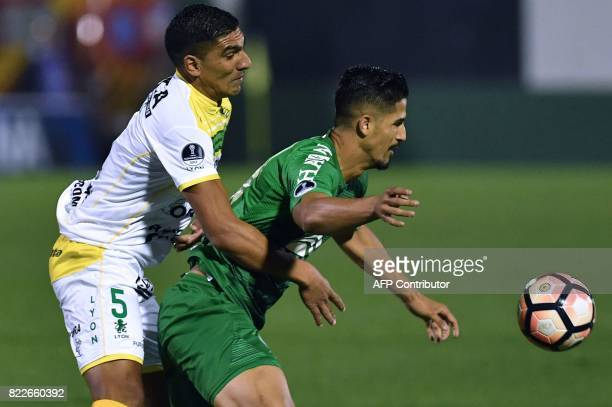 Luis Jerez of Argentina's Defensa y Justicia vies for the ball with Tulio de Melo of Brazil's Chapecoense during their Copa Sudamericana football...