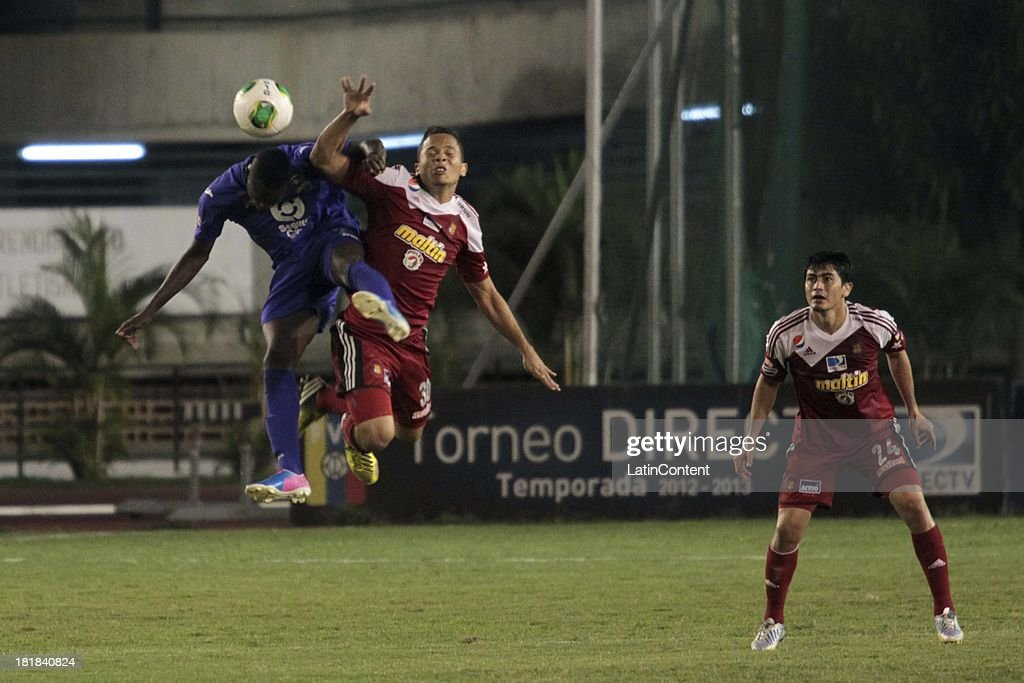 Luis Jimenez of Caracas FC jumps for the ball during a match between Caracas FC and Deportivo La Guaira as part of the Apertura 2013 at Brígido Iriarte Stadium on September 25, 2013 in Caracas, Venezuela.