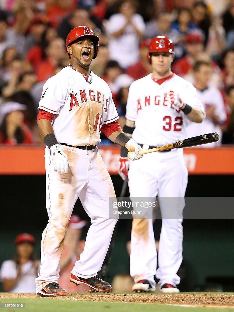 Luis Jimenez #18 of the Los Angeles Angels of Anaheim celebrates in front of on deck batter Josh Hamilton #32 after scoring a run in the seventh inning against the Detroit Tigers at Angel Stadium of Anaheim on April 19, 2013 in Anaheim, California.