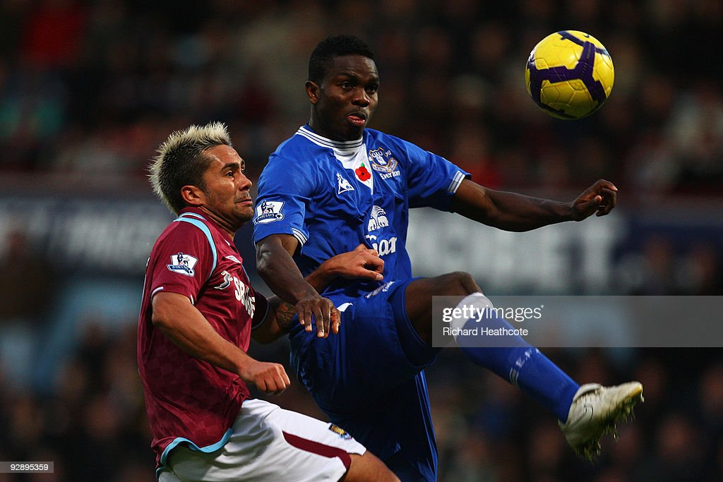 Luis Jimenez of West Ham and <a gi-track='captionPersonalityLinkClicked' href=/galleries/search?phrase=Joseph+Yobo&family=editorial&specificpeople=220395 ng-click='$event.stopPropagation()'>Joseph Yobo</a> of Everton go for the ball during the Barclays Premier League match between West Ham United and Everton at Upton Park on November 8, 2009 in London, England.