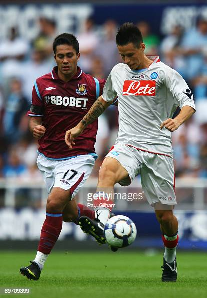 Luis Jimenez of West Ham United battles for the ball with Marek Hamsik of Napoli during the Bobby Moore Cup between West Ham United and Napoli at...