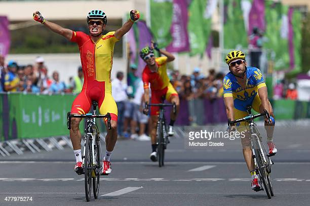 Luis Leon Sanchez Gil of Spain celebrates winning gold from Andriy Grivko of Ukraine in the Men's Road Race during day nine of the Baku 2015 European...