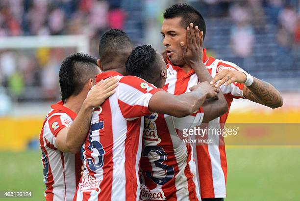 Luis Lopez of Atletico Junior celebrates with his teammates after scoring during match for the second round of the Liga Aguila I 2015 at...