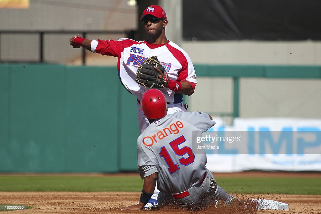 Luis Mateo of Puerto Rico and Miguel Tejeda of Republica Dominicana during the Caribbean Series Baseball 2013 in Sonora Stadium on february 2, 2013 in Hermosillo, Mexico.