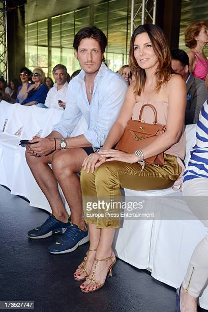 Luis Medina and Mar Flores attend 'Emidio Tucci Black' parade photocall Costume Museum on July 15 2013 in Madrid Spain