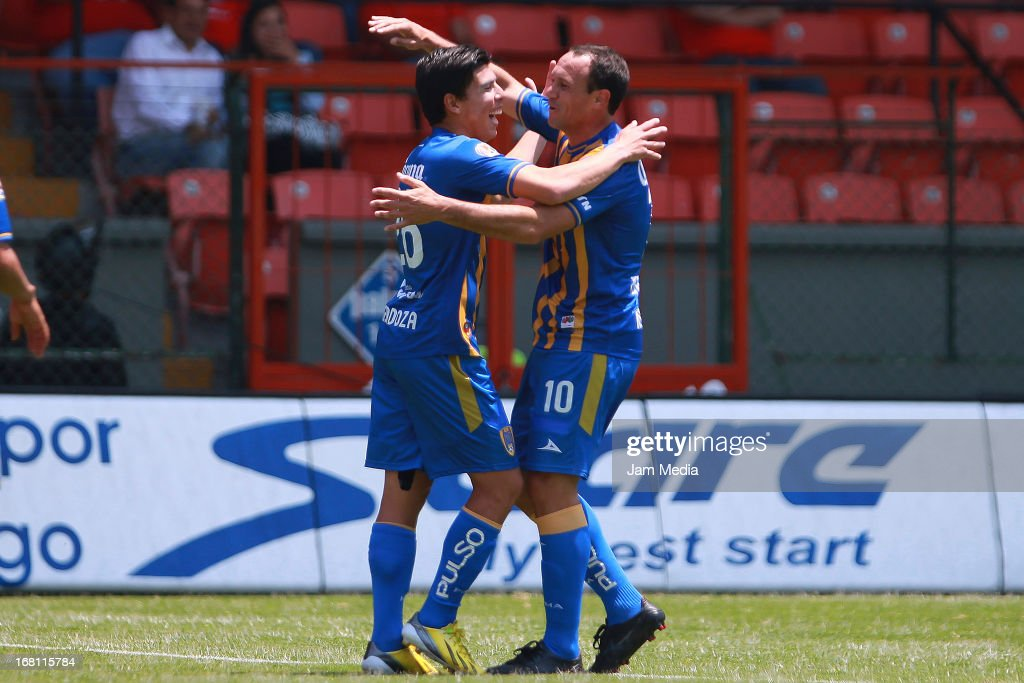 Luis Mendoza and Gustavo Matos of San Luis celebrate a scored goal during a match between Toluca and San Luis as part of the Clausura 2013 Liga MX at...